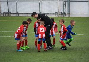 Kids playing football.